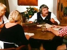 Farm old man pleases younger blondie on his dining table