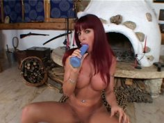 Gorgeous redhead Sonya drills her pussy with long dildo